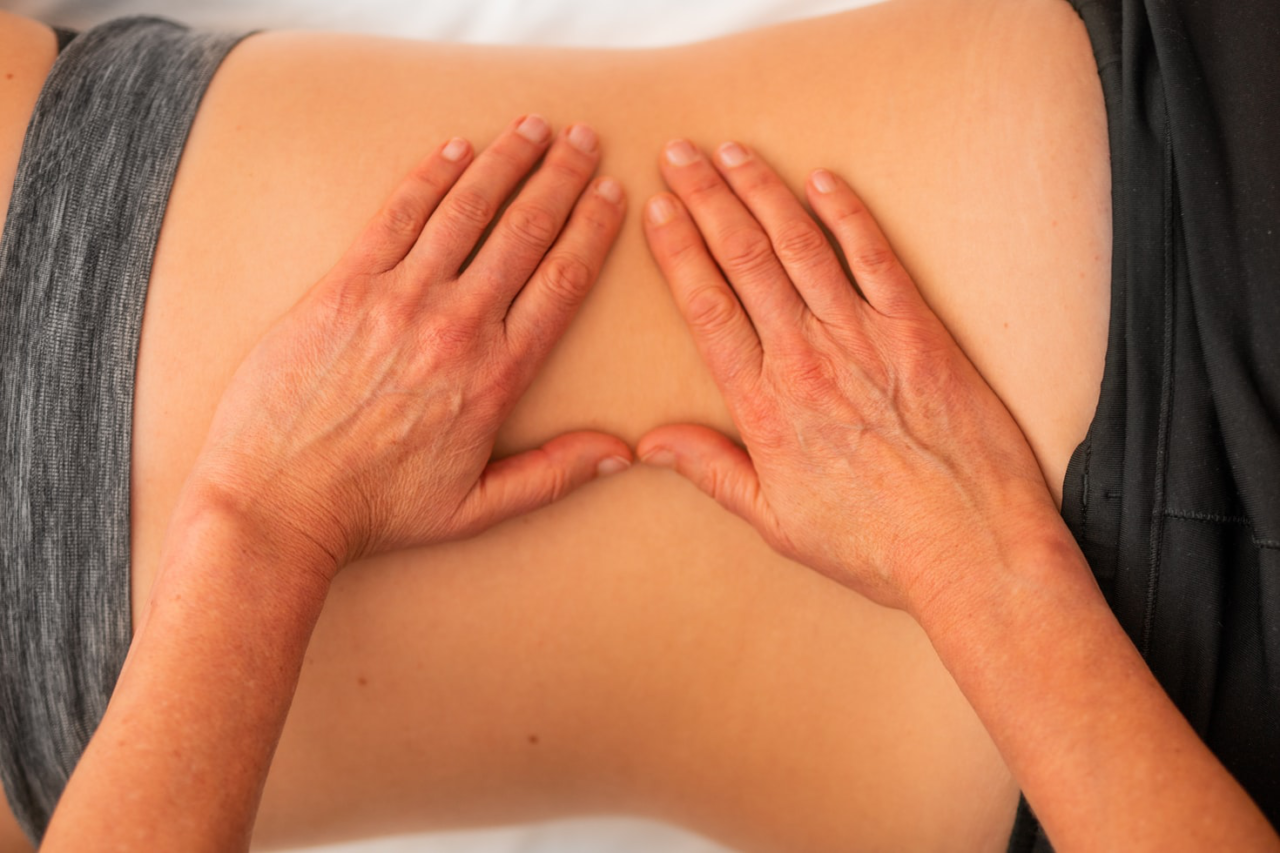 A chiropractor performing spinal manipulation